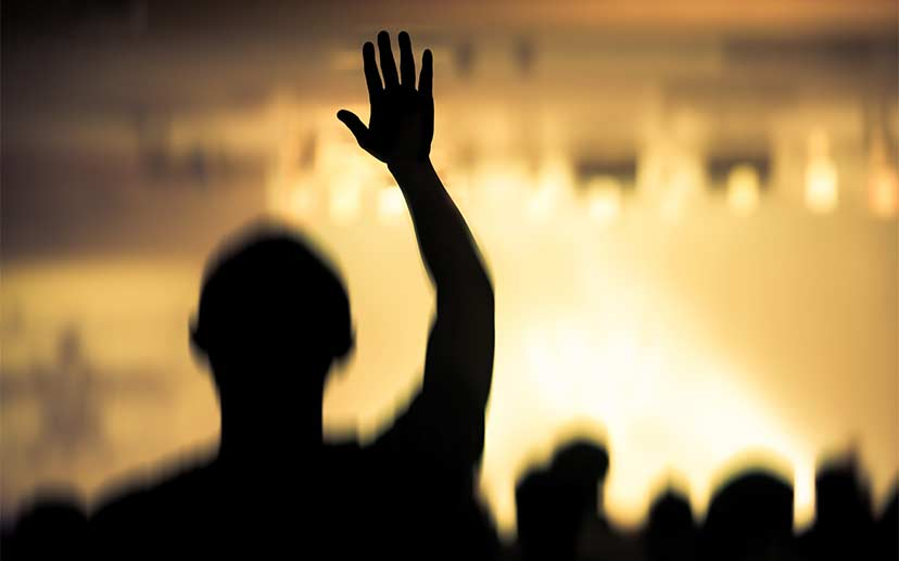 worshipper raising a hand